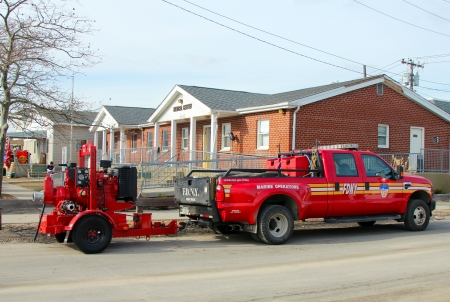 breezy: BREEZY POINT, NY - NOVEMBER 15: Fire department marine operations truck with water pump  moved to flooded area in the aftermath of Hurricane Sandy on November 15, 2012 in Breezy Point, NY
