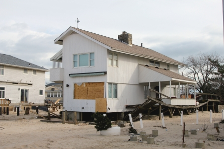 breezy: BREEZY POINT, NY - NOVEMBER 15: Destroyed beach house in the aftermath of Hurricane Sandy on November 15, 2012 in Breezy Point, NY Editorial