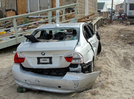 breezy: BREEZY POINT, NY - NOVEMBER 15: Destroyed car in the aftermath of Hurricane Sandy on November 15, 2012 in Breezy Point, NY