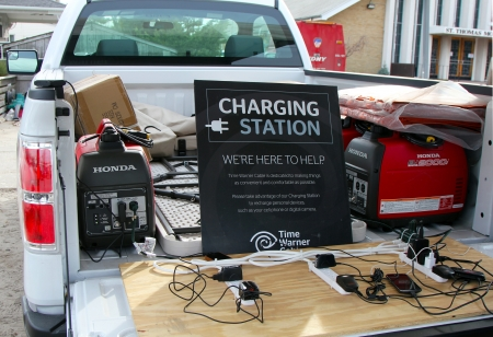 breezy: BREEZY POINT, NY - NOVEMBER 15: Mobile charging station  in devastated area in the aftermath of Hurricane Sandy on November 15, 2012 in Breezy Point, NY