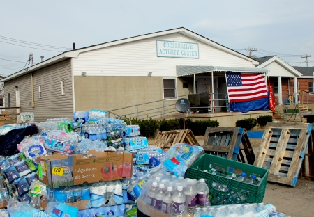 breezy: BREEZY POINT, NY - NOVEMBER 15: Water and supplies  in devastated area in the aftermath of Hurricane Sandy on November 15, 2012 in Breezy Point, NY Editorial