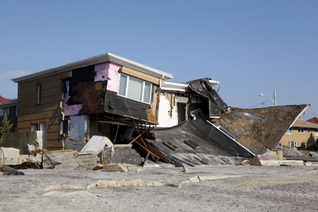 FAR ROCKAWAY, NY - NOVEMBER 11: Destroyed beach houses in the aftermath of Hurricane Sandy on November 11, 2012 in Far Rockaway, NY Редакционное
