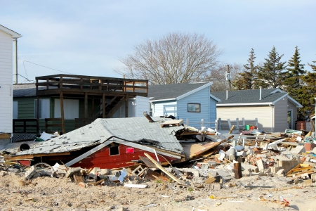 BREEZY POINT, NY - NOVEMBER 20: Destroyed beach  houses in the aftermath of Hurricane Sandy on November 20, 2012 in Breezy Point, NY.  Редакционное