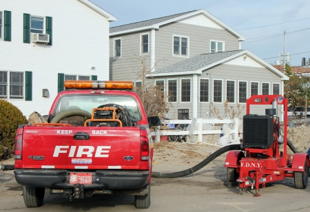 breezy: BREEZY POINT, NY - NOVEMBER 20: Fire department marine operations truck with water pump  moved to flooded area in the aftermath of Hurricane Sandy on November 20, 2012 in Breezy Point, NY