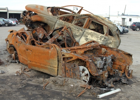 breezy: BREEZY POINT, NY - NOVEMBER 20: Burned cars in the aftermath of Hurricane Sandy on November 20, 2012 in Breezy Point, NY.