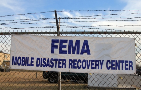 devastated: BREEZY POINT, NY - NOVEMBER 15: FEMA opens disaster recovery center in devastated area in the aftermath of Hurricane Sandy on November 15, 2012 in Breezy Point, NY  Editorial