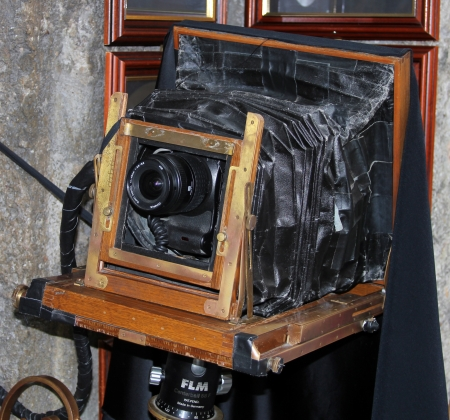 VIENNA, AUSTRIA - SEPTEMBER 1:Vintage photo camera in front of photoshop on September 1, 2012 in Vienna, Austria