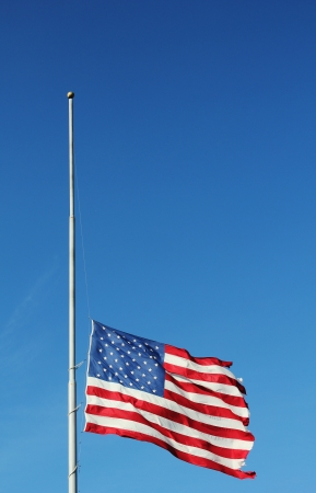 American flag flying at half staff in memory of Newtown massacre victims  President Obama Orders US Flags Lowered To Half-Staff For Victims Of Newtown Shooting on December 14, 2012