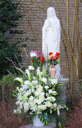 sanctified: BROOKLYN, NEW YORK - DECEMBER 23: Statue of the blessed virgin Mary outside of St. Mark Roman Catholic Church on December 23, 2012 in Brooklyn, New York