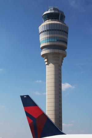 ATLANTA, GEORGIA - AUGUST 27: Delta plane next to Air Traffic Control Tower at Atlanta Hartsfield-Jackson Airport on  August 27, 2012 in Atlanta, Georgia. Stock Photo - 17378037