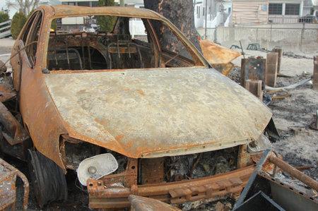 breezy: BREEZY POINT, NY - NOVEMBER 20: Burned car in the aftermath of Hurricane Sandy on November 20, 2012 in Breezy Point, NY
