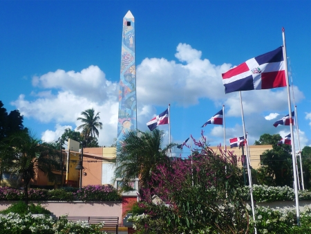 LA ROMANA, DOMINICAN REPUBLIC- DECEMBER 29: Central square obelisk decorated with images associated with La Romana on December 29, 2011