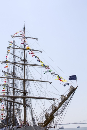 Tall ship with nautical flags