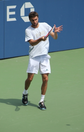 flushing: FLUSHING, NY - AUGUST 21: Professional tennis player Gilles Simon practices for US Open at Billie Jean King National Tennis Center on August 21, 2012 in Flushing, NY