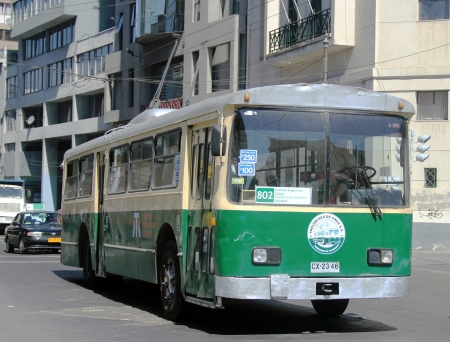 utilitarian: VALPARAISO, CHILE - MARCH 23:1952-built Pullman-Standard trolleybus on the street of Valparaiso on March 23, 2012. It is  the icon of the city, considered an important part of its cultural heritage.
