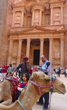 PETRA, JORDAN - NOVEMBER 16: Bedouin camel in  front of the ancient Treasury on November 16, 2010 in Petra, Jordan.  Petra has been a UNESCO World Heritage Site since 1985