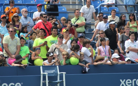 grand hard: FLUSHING, NY - AUGUST 25: Tennis fans waiting for autographs at  Billie Jean King National Tennis Center on August 25, 2012 in Flushing, NY. US Open is a final Grand Slam tournament of the year