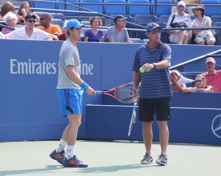 FLUSHING, NY - AUGUST 23: Grand Slam champion Andy Murray with his coach Ivan Lendl practices for US Open at Louis Armstrong Stadium at Billie Jean King National Tennis Center on August 23, 2012 in Flushing, NY.  Stock Photo - 17522935