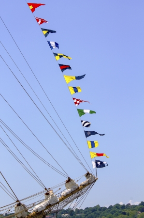 Tall ship with nautical flags  photo