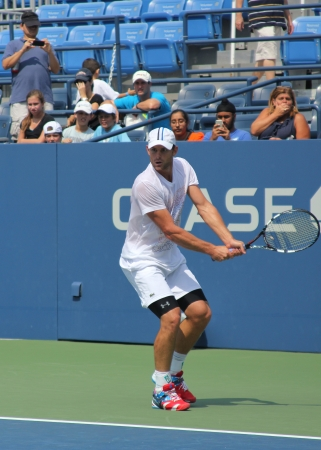louis armstrong: FLUSHING, NY - AUGUST 25: Grand Slam champion Andy Roddick practices for US Open at Louis Armstrong Stadium at Billie Jean King National Tennis Center on August 25, 2012 in Flushing, NY.