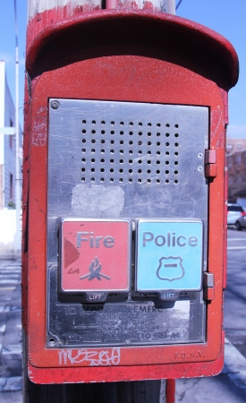 BROOKLYN,NEW YORK - FEBRUARY 14: Emergency Reporting System box with buttons to notify the police and fire department February 14, 2013 in Brooklyn, New York