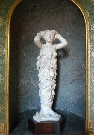 explicit: PARIS, FRANCE - AUGUST 19:Polymast statue of Nature by Tribolo at Palace of Fontainebleau near Paris on August 19, 2011. The attributes of Artemis of Ephesus have been adopted in highly explicit terms to create a Goddess of Nature Editorial