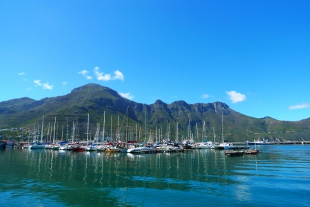 CAPE TOWN, SOUTH AFRICA -  SEPTEMBER 12:The Sentinel Peak at the Hout Bay harbour near Cape Town, South Africa on September 12, 2009 Stock Photo - 18115453