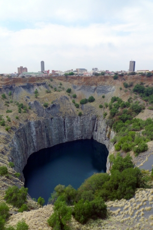 the largest: The Big Hole  in Kimberley, South Africa  It is an open-pit and underground diamond mine and claimed to be the largest hole excavated by hand
