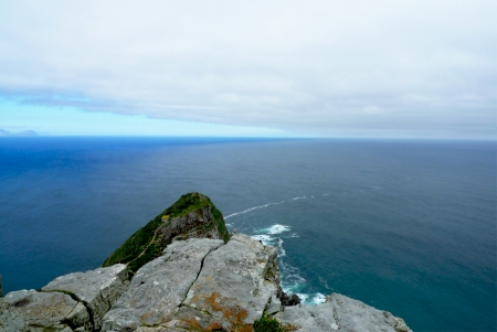 Panoramic view from Cape Point, the most South-Western point of African continent   It is also the point where the  Indian Ocean  at the left   and Atlantic Ocean  at the right   meet   photo