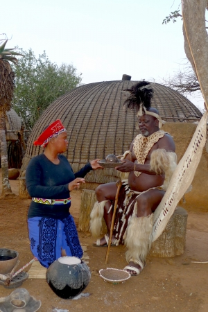 traditional culture: ZULULAND, SOUTH AFRICA - SEPTEMBER 14: Zulu Chief with his wife in Shakaland Zulu Village on September 14, 2009. A unique cultural center built on the set of  movies Shaka Zulu and John Ross.