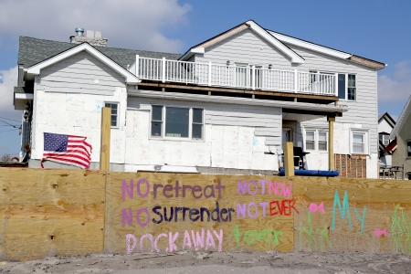 far rockaway: FAR ROCKAWAY, NY - FEBRUARY 28: Signs in front of damaged beach house in devastated area four months after Hurricane Sandy on February, 28, 2013 in Far Rockaway, NY