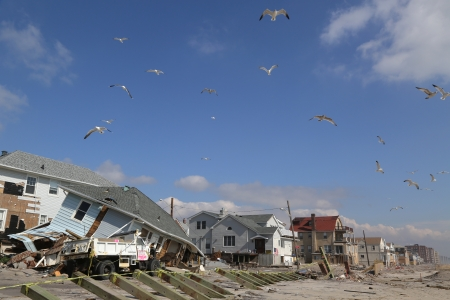 FAR ROCKAWAY, NY - FEBRUARY 28: Destroyed beach house and truck four months after  Hurricane Sandy on February, 28, 2013 in Far Rockaway, NY