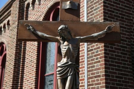 青銅色の彫像のイエス ・ キリストの十字架 写真素材