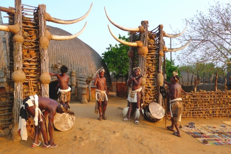 ZULULAND, SOUTH AFRICA - SEPTEMBER 14: Zulu worriers in Shakaland Zulu Village on September 14, 2009. A unique cultural center built on the set of movies Shaka Zulu and John Ross.