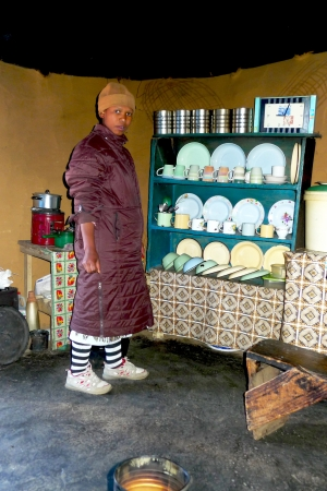 african culture: SANI PASS,LESOTHO -SEPTEMBER 19:Unidentified Lesotho women inside of the traditional house at Sani Pass on September 19, 2009.The Kingdom of Lesotho is a landlocked country and enclave