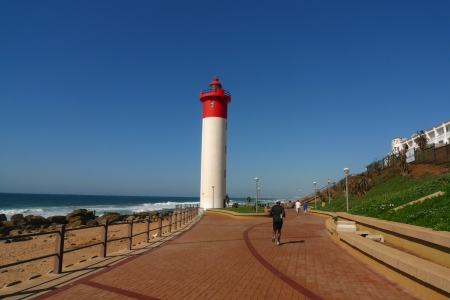 Durban boardwalk along Indian Ocean and Umhlanga lighthouse in Umhlanga Rocks, a seaside town in the northern suburbs of Durban. South Africa