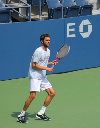 FLUSHING, NY - AUGUST 21: Professional tennis player Gilles Simon practices for US Open at Louis Armstrong Stadium at Billie Jean King National Tennis Center on August 21, 2012 in Flushing, NY. Stock Photo - 18432317
