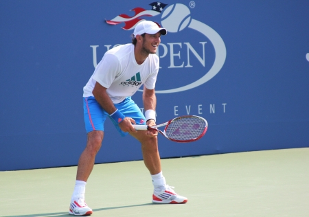 louis armstrong: FLUSHING, NY - AUGUST 23: Professional tennis player Juan Monaco practices for US Open at Louis Armstrong Stadium at Billie Jean King National Tennis Center on August 23, 2012 in Flushing, NY.  Editorial