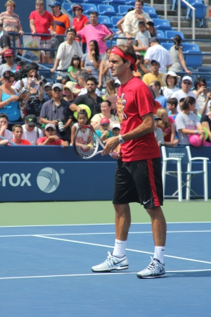 louis armstrong: FLUSHING, NY - AUGUST 25: Seventeen times  Grand Slam champion Roger Federer practices for US Open at Louis Armstrong Stadium at Billie Jean King National Tennis Center on August 25, 2012 in Flushing, NY.  Editorial