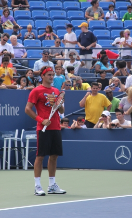 grand hard: FLUSHING, NY - AUGUST 25: Seventeen times  Grand Slam champion Roger Federer practices for US Open at Louis Armstrong Stadium at Billie Jean King National Tennis Center on August 25, 2012 in Flushing, NY.  Editorial