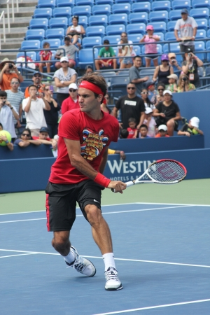 flushing: FLUSHING, NY - AUGUST 25: Seventeen times  Grand Slam champion Roger Federer practices for US Open at Louis Armstrong Stadium at Billie Jean King National Tennis Center on August 25, 2012 in Flushing, NY.  Editorial