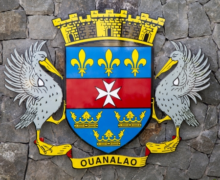 The coat of arms of Saint Barthelemy (St. Barths). On a white background, it serves as the unofficial Flag of St. Barths. Sajtókép