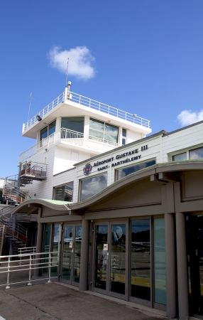 runways: ST BARTHS, FRENCH WEST INDIES - NOVEMBER 5:  Gustaf III Airport terminal and traffic control tower on November 9, 2012 at St. Barths. It has one of the shortest runways in the world