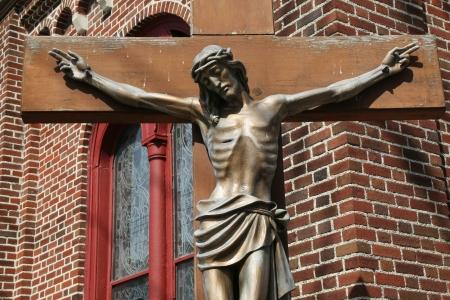 Bronze statue of Jesus Christ crucified photo