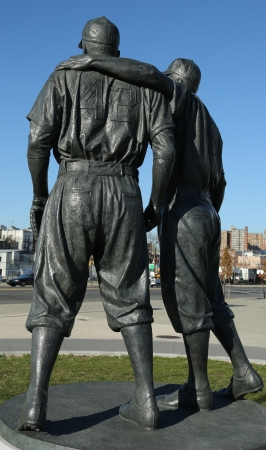 BROOKLYN, NY - APRIL 6: Jackie Robinson and  Pee Wee Reese Statue in Brooklyn in front of MCU ballpark on April 6, 2013. 42 is an upcoming 2013 Hollywood film about baseball player Jackie Robinson Stock Photo - 18900137