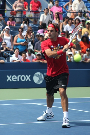 FLUSHING, NY - AUGUST 25: Seventeen times Grand Slam champion Roger Federer practices for US Open at Louis Armstrong Stadium at Billie Jean King National Tennis Center on August 25, 2012 in Flushing, NY.  Editorial