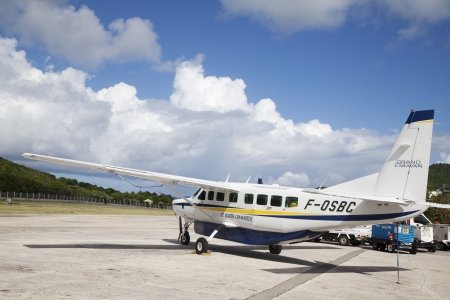 collectivity: ST. BARTHS, FRENCH WEST INDIES -NOVEMBER 5: St Barth commuter aircraft ready to take off on November 5, 2012 at St Barths airport. St. Barth commuter is a local airline founded in 1995.