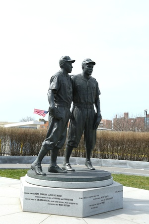 wee: BROOKLYN, NY - APRIL 9: Jackie Robinson and Pee Wee Reese Statue in Brooklyn in front of MCU ballpark on April 9, 2013. 42 is an upcoming 2013 Hollywood film about baseball player Jackie Robinson  Editorial
