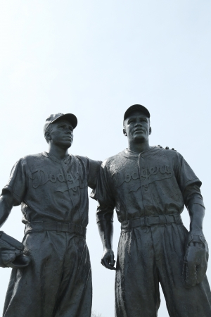 BROOKLYN, NY - APRIL 9: Jackie Robinson and Pee Wee Reese Statue in Brooklyn in front of MCU ballpark on April 9, 2013. 42 is an upcoming 2013 Hollywood film about baseball player Jackie Robinson  Stock Photo - 18979144
