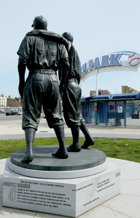 BROOKLYN, NY - APRIL 9: Jackie Robinson and Pee Wee Reese Statue in Brooklyn in front of MCU ballpark on April 9, 2013. 42 is an upcoming 2013 Hollywood film about baseball player Jackie Robinson  Stock Photo - 18979148